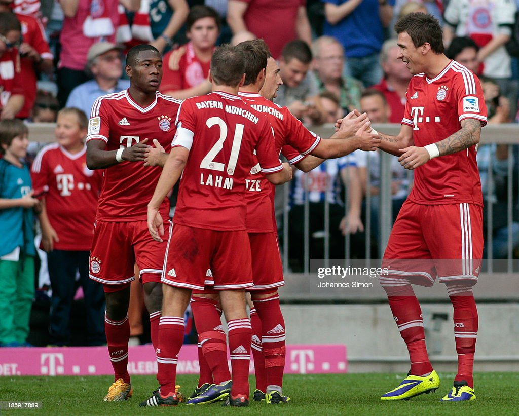 <a gi-track='captionPersonalityLinkClicked' href=/galleries/search?phrase=Mario+Mandzukic&family=editorial&specificpeople=4476149 ng-click='$event.stopPropagation()'>Mario Mandzukic</a> (R) of Muenchen celebrates after scoring his team's first goal during the Bundesliga match between FC Bayern Muenchen and Hertha BSC Berlin at Allianz Arena at Allianz Arena on October 26, 2013 in Munich, Germany.