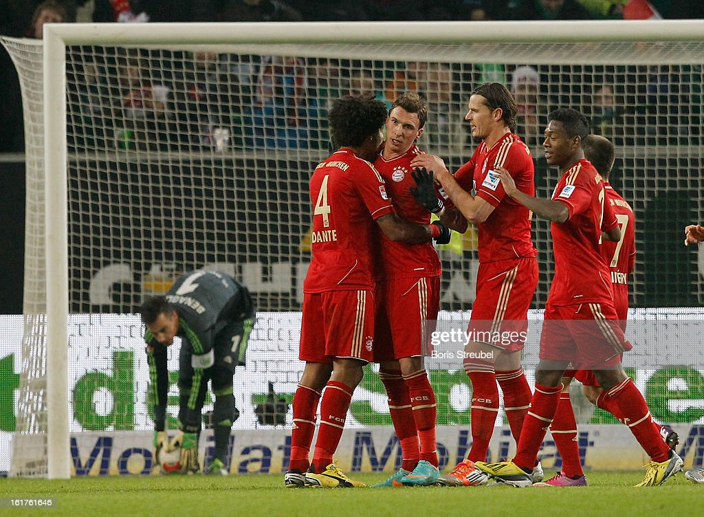 Mario Mandzukic (3.L) of Muenchen celebrates his team's first goal with his team mates during goalkeeper Diego Benaglio (L) picks up the ball out of the goal during the Bundesliga match between VFL Wolfsburg and FC Bayern Muenchen at Volkswagen Arena on February 15, 2013 in Wolfsburg, Germany.