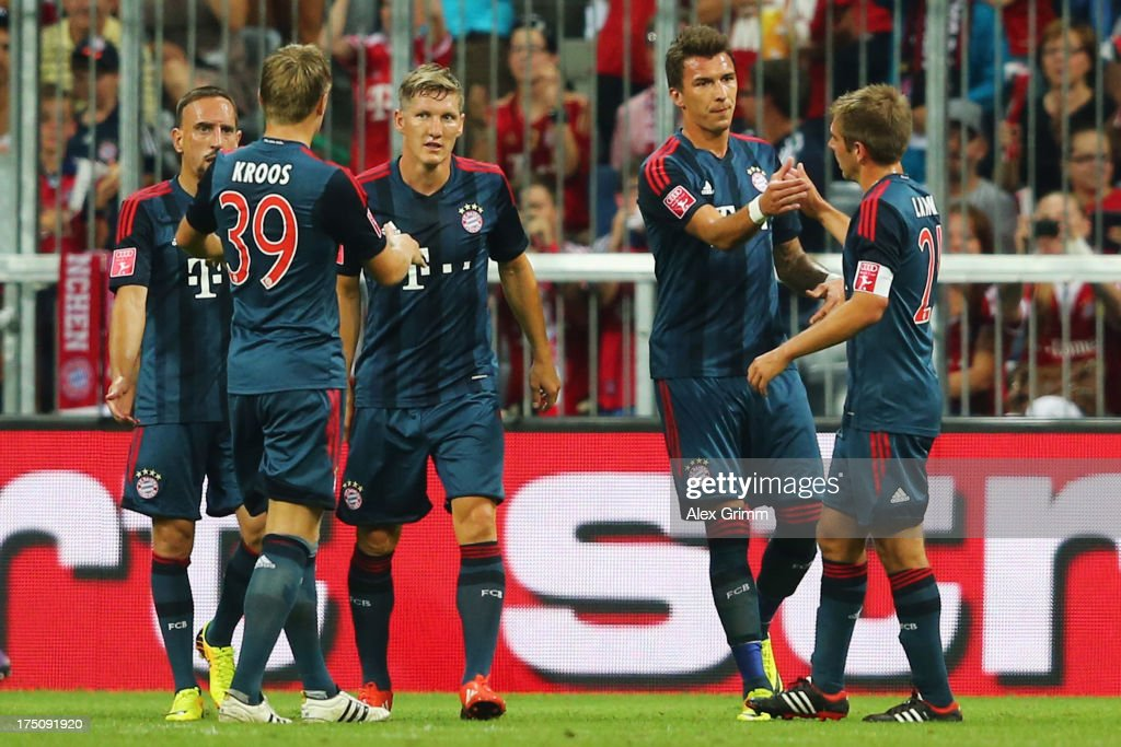 <a gi-track='captionPersonalityLinkClicked' href=/galleries/search?phrase=Mario+Mandzukic&family=editorial&specificpeople=4476149 ng-click='$event.stopPropagation()'>Mario Mandzukic</a> (2R) of Muenchen celebrates his team's first goal with team mates <a gi-track='captionPersonalityLinkClicked' href=/galleries/search?phrase=Philipp+Lahm&family=editorial&specificpeople=483746 ng-click='$event.stopPropagation()'>Philipp Lahm</a>, <a gi-track='captionPersonalityLinkClicked' href=/galleries/search?phrase=Bastian+Schweinsteiger&family=editorial&specificpeople=203122 ng-click='$event.stopPropagation()'>Bastian Schweinsteiger</a>, <a gi-track='captionPersonalityLinkClicked' href=/galleries/search?phrase=Toni+Kroos&family=editorial&specificpeople=638597 ng-click='$event.stopPropagation()'>Toni Kroos</a> and <a gi-track='captionPersonalityLinkClicked' href=/galleries/search?phrase=Franck+Ribery&family=editorial&specificpeople=490869 ng-click='$event.stopPropagation()'>Franck Ribery</a> (R-L) during the Audi Cup match between FC Bayern Muenchen and FC Sao Paulo at Allianz Arena on July 31, 2013 in Munich, Germany.