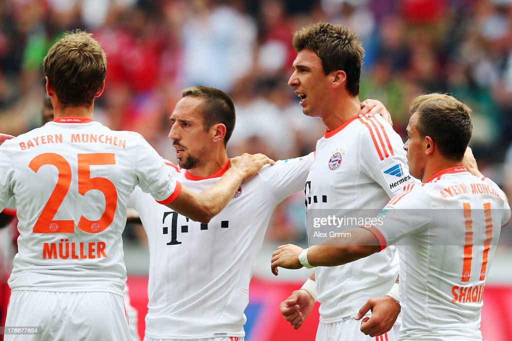 <a gi-track='captionPersonalityLinkClicked' href=/galleries/search?phrase=Mario+Mandzukic&family=editorial&specificpeople=4476149 ng-click='$event.stopPropagation()'>Mario Mandzukic</a> (2R) of Muenchen celebrates his team's first goal with team mates <a gi-track='captionPersonalityLinkClicked' href=/galleries/search?phrase=Xherdan+Shaqiri&family=editorial&specificpeople=6923918 ng-click='$event.stopPropagation()'>Xherdan Shaqiri</a>, <a gi-track='captionPersonalityLinkClicked' href=/galleries/search?phrase=Franck+Ribery&family=editorial&specificpeople=490869 ng-click='$event.stopPropagation()'>Franck Ribery</a> and <a gi-track='captionPersonalityLinkClicked' href=/galleries/search?phrase=Thomas+Mueller&family=editorial&specificpeople=5842906 ng-click='$event.stopPropagation()'>Thomas Mueller</a> (R-L) during the Bundesliga match between Eintracht Frankfurt and FC Bayern Muenchen at Commerzbank Arena on August 17, 2013 in Frankfurt am Main, Germany.
