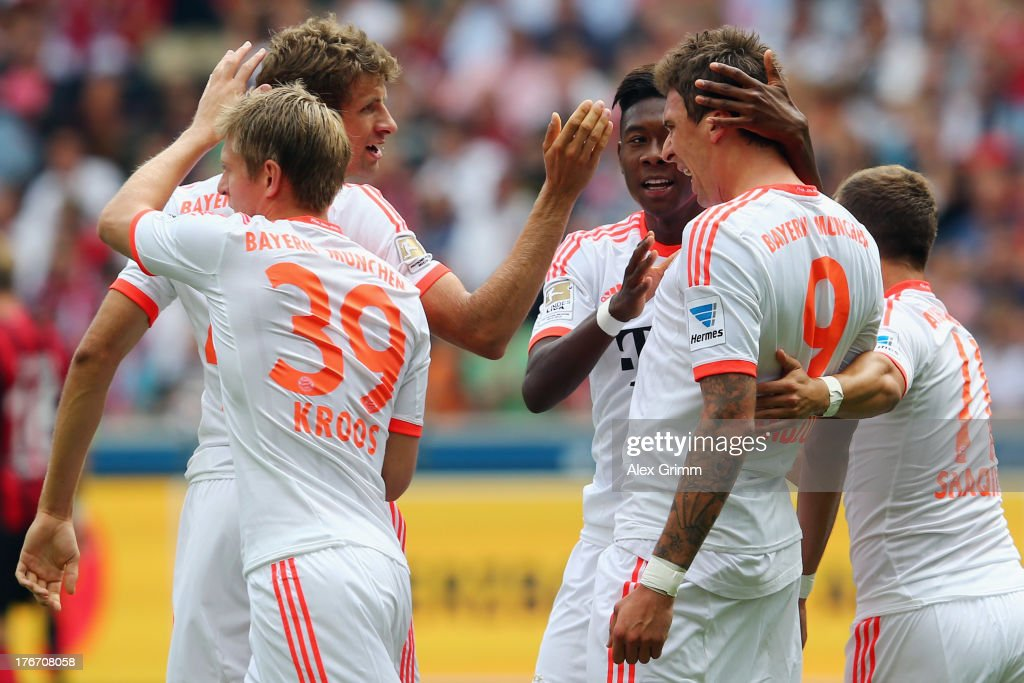 <a gi-track='captionPersonalityLinkClicked' href=/galleries/search?phrase=Mario+Mandzukic&family=editorial&specificpeople=4476149 ng-click='$event.stopPropagation()'>Mario Mandzukic</a> of Muenchen celebrates his team's first goal with team mates <a gi-track='captionPersonalityLinkClicked' href=/galleries/search?phrase=Toni+Kroos&family=editorial&specificpeople=638597 ng-click='$event.stopPropagation()'>Toni Kroos</a>, <a gi-track='captionPersonalityLinkClicked' href=/galleries/search?phrase=Thomas+Mueller&family=editorial&specificpeople=5842906 ng-click='$event.stopPropagation()'>Thomas Mueller</a>, <a gi-track='captionPersonalityLinkClicked' href=/galleries/search?phrase=David+Alaba&family=editorial&specificpeople=5494608 ng-click='$event.stopPropagation()'>David Alaba</a> and <a gi-track='captionPersonalityLinkClicked' href=/galleries/search?phrase=Philipp+Lahm&family=editorial&specificpeople=483746 ng-click='$event.stopPropagation()'>Philipp Lahm</a> during the Bundesliga match between Eintracht Frankfurt and FC Bayern Muenchen at Commerzbank Arena on August 17, 2013 in Frankfurt am Main, Germany.