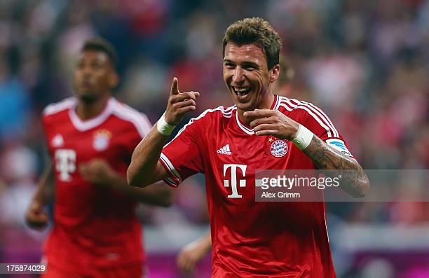 Mario Mandzukic of Muenchen celebrates his team's second goal during the Bundesliga match between Bayern Muenchen and Borussia Moenchengladbach at...