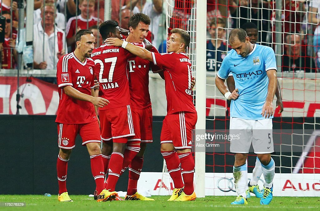 <a gi-track='captionPersonalityLinkClicked' href=/galleries/search?phrase=Mario+Mandzukic&family=editorial&specificpeople=4476149 ng-click='$event.stopPropagation()'>Mario Mandzukic</a> of Muenchen celebrates his team's second goal with team mates during the Audi Cup Final match between FC Bayern Muenchen and Manchester City at Allianz Arena on August 1, 2013 in Munich, Germany.