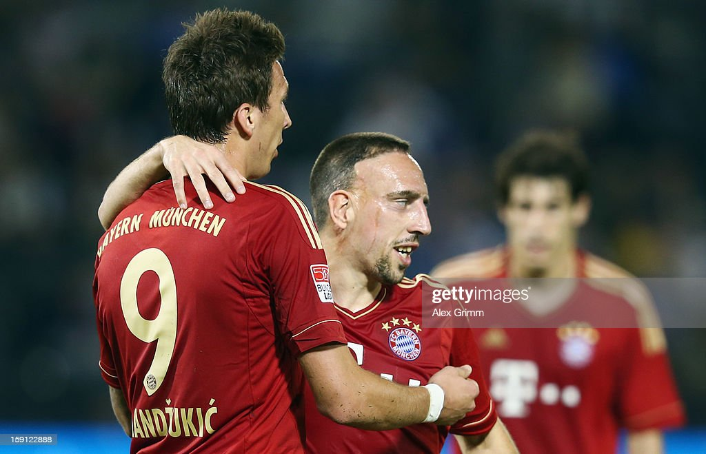 <a gi-track='captionPersonalityLinkClicked' href=/galleries/search?phrase=Mario+Mandzukic&family=editorial&specificpeople=4476149 ng-click='$event.stopPropagation()'>Mario Mandzukic</a> (L) of Muenchen celebrates his team's third goal with team mate <a gi-track='captionPersonalityLinkClicked' href=/galleries/search?phrase=Franck+Ribery&family=editorial&specificpeople=490869 ng-click='$event.stopPropagation()'>Franck Ribery</a> during the friendly match between Bayern Muenchen and FC Schalke 04 at Jassim Bin Hamad Stadium on January 8, 2013 in Doha, Qatar.