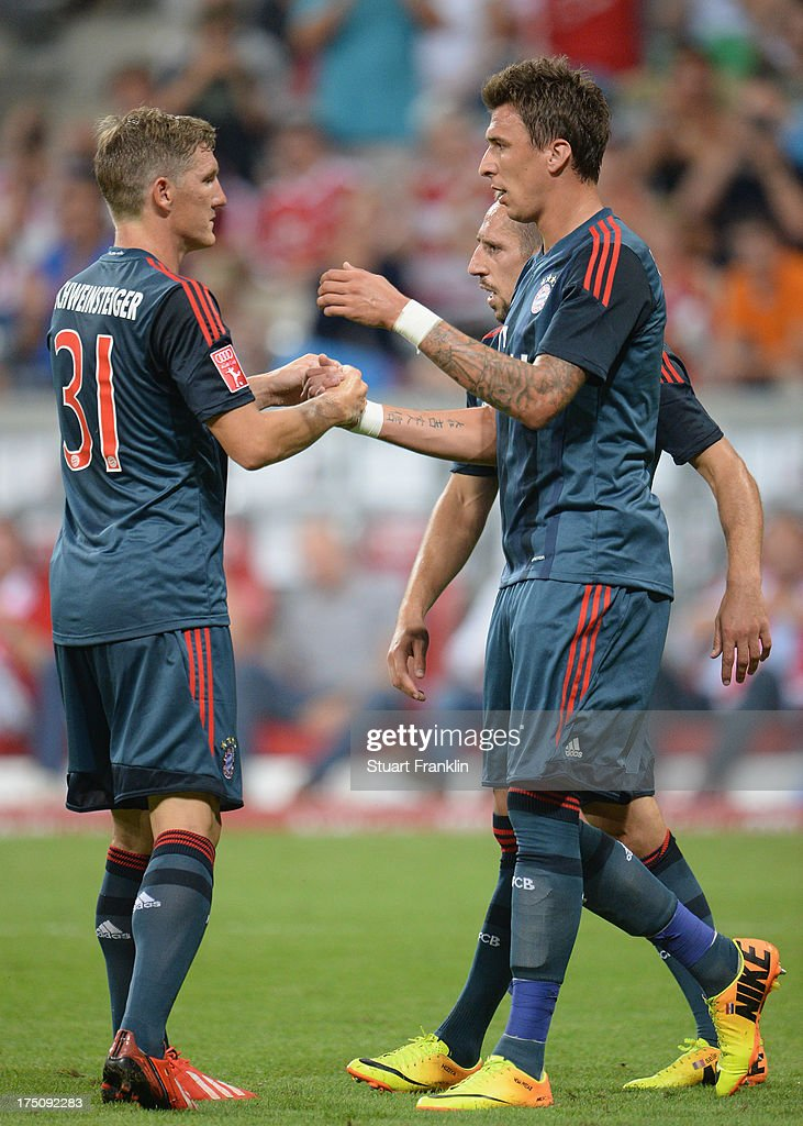 <a gi-track='captionPersonalityLinkClicked' href=/galleries/search?phrase=Mario+Mandzukic&family=editorial&specificpeople=4476149 ng-click='$event.stopPropagation()'>Mario Mandzukic</a> of Muenchen celebrates scoring his goal with Bastian Schweinstieger and <a gi-track='captionPersonalityLinkClicked' href=/galleries/search?phrase=Franck+Ribery&family=editorial&specificpeople=490869 ng-click='$event.stopPropagation()'>Franck Ribery</a> during the Audi cup match between FC Bayern Muenchen and FC Sao Paulo at Allianz Arena on July 31, 2013 in Munich, Germany.