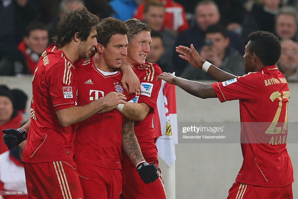 <a gi-track='captionPersonalityLinkClicked' href=/galleries/search?phrase=Mario+Mandzukic&family=editorial&specificpeople=4476149 ng-click='$event.stopPropagation()'>Mario Mandzukic</a> (2nd L) of Muenchen celebrates scoring the opening goal with his team mates Javi Martinez (L), Bastian Schweinteiger (2nd R) and <a gi-track='captionPersonalityLinkClicked' href=/galleries/search?phrase=David+Alaba&family=editorial&specificpeople=5494608 ng-click='$event.stopPropagation()'>David Alaba</a> (R) during the Bundesliga match between VfB Stuttgart and FC Bayern Muenchen at Mercedes-Benz Arena on January 27, 2013 in Stuttgart, Germany.