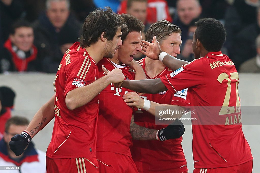 Mario Mandzukic (2nd L) of Muenchen celebrates scoring the opening goal with his team mates Javi Martinez (L), Bastian Schweinteiger (2nd R) and David Alaba (R) during the Bundesliga match between VfB Stuttgart and FC Bayern Muenchen at Mercedes-Benz Arena on January 27, 2013 in Stuttgart, Germany.