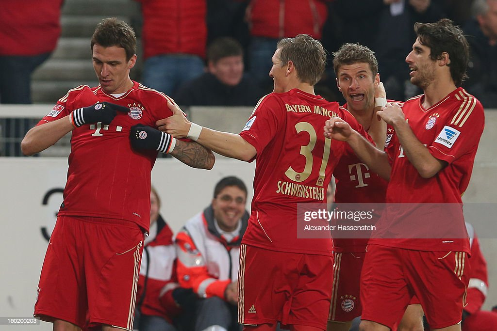<a gi-track='captionPersonalityLinkClicked' href=/galleries/search?phrase=Mario+Mandzukic&family=editorial&specificpeople=4476149 ng-click='$event.stopPropagation()'>Mario Mandzukic</a> (L) of Muenchen celebrates scoring the opening goal with his team mates Javi Martinez (R), Bastian Schweinteiger (2nd L) and Thomas Mueller (2nd R) during the Bundesliga match between VfB Stuttgart and FC Bayern Muenchen at Mercedes-Benz Arena on January 27, 2013 in Stuttgart, Germany.