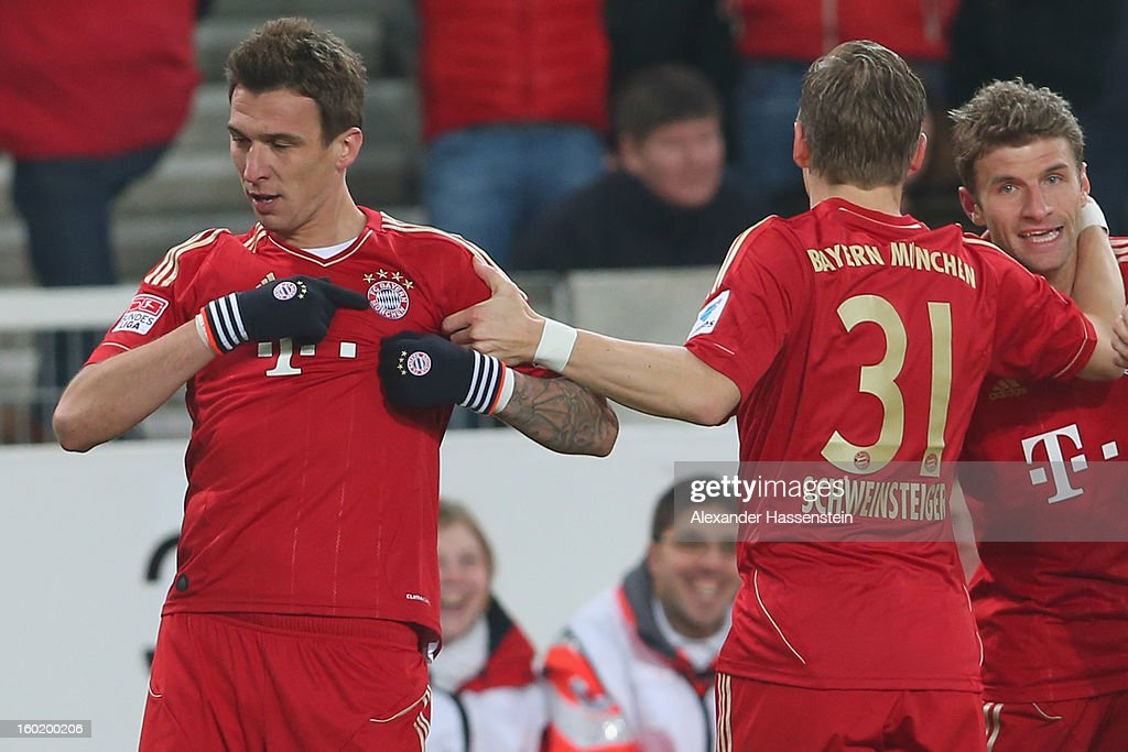 Mario Mandzukic (L) of Muenchen celebrates scoring the opening goal with his team mates Bastian Schweinteiger (C) and Thomas Mueller (R) during the Bundesliga match between VfB Stuttgart and FC Bayern Muenchen at Mercedes-Benz Arena on January 27, 2013 in Stuttgart, Germany.