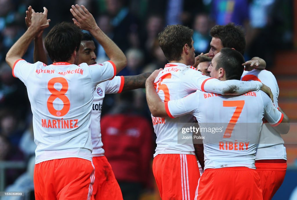 Mario Mandzukic (R) of Muenchen celebrates with his team mates after scoring his team's second goal during the Bundesliga match between SV Werder Bremen and FC Bayern Muenchen at Weser Stadium on September 29, 2012 in Bremen, Germany.