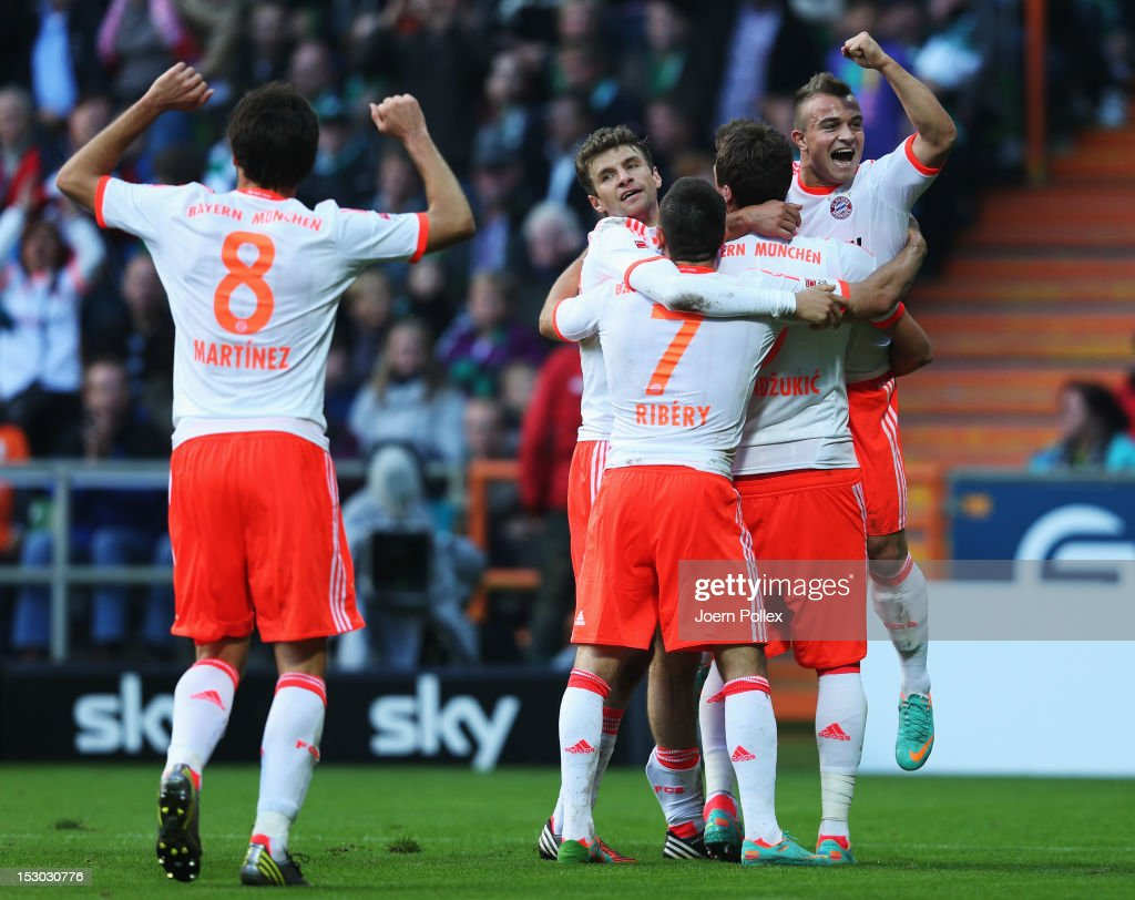 Mario Mandzukic (2nd R) of Muenchen celebrates with his team mates after scoring his team's second goal during the Bundesliga match between SV Werder Bremen and FC Bayern Muenchen at Weser Stadium on September 29, 2012 in Bremen, Germany.
