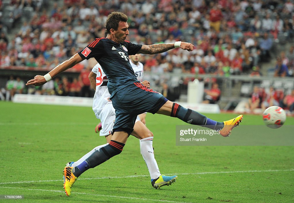 <a gi-track='captionPersonalityLinkClicked' href=/galleries/search?phrase=Mario+Mandzukic&family=editorial&specificpeople=4476149 ng-click='$event.stopPropagation()'>Mario Mandzukic</a> of Muenchen in action during the Audi cup match between FC Bayern Muenchen and FC Sao Paulo at Allianz Arena on July 31, 2013 in Munich, Germany.