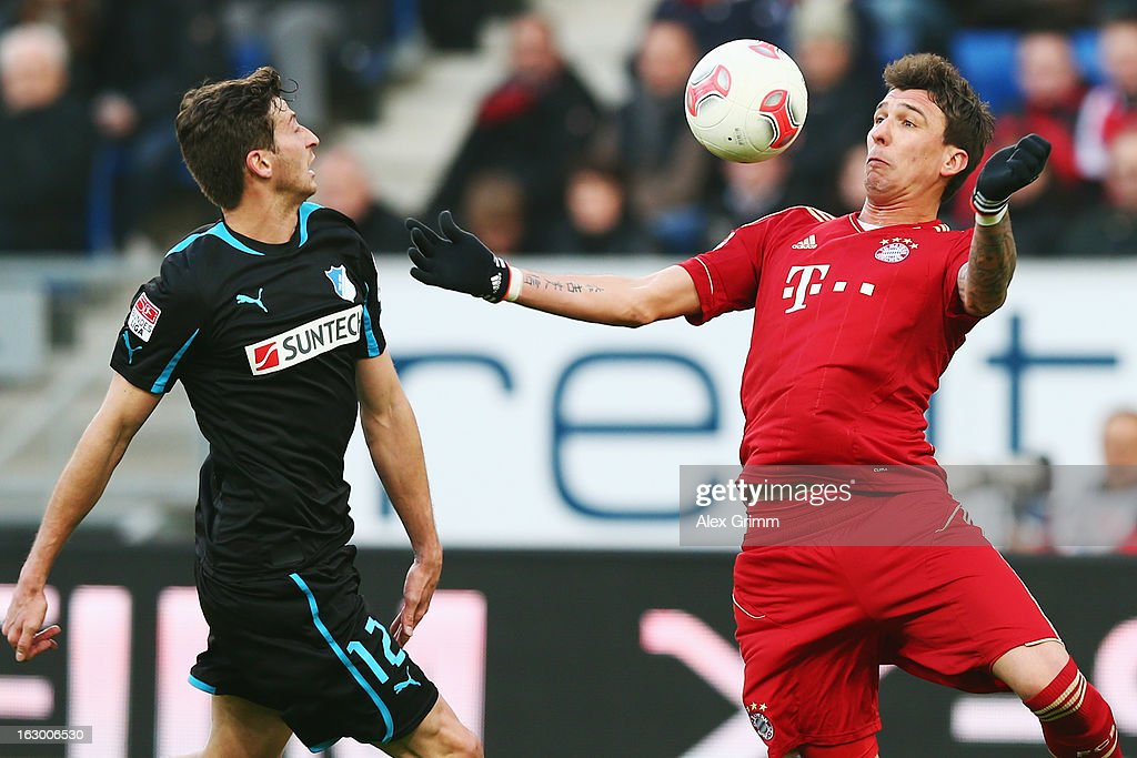 <a gi-track='captionPersonalityLinkClicked' href=/galleries/search?phrase=Mario+Mandzukic&family=editorial&specificpeople=4476149 ng-click='$event.stopPropagation()'>Mario Mandzukic</a> (R) of Muenchen is challenged by David Abraham of Hoffenheim during the Bundesliga match between TSG 1899 Hoffenheim and FC Bayern Muenchen at Rhein-Neckar-Arena on March 3, 2013 in Sinsheim, Germany.