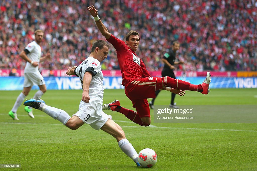 <a gi-track='captionPersonalityLinkClicked' href=/galleries/search?phrase=Mario+Mandzukic&family=editorial&specificpeople=4476149 ng-click='$event.stopPropagation()'>Mario Mandzukic</a> (R) of Muenchen is challenged by <a gi-track='captionPersonalityLinkClicked' href=/galleries/search?phrase=Zdenek+Pospech&family=editorial&specificpeople=2201495 ng-click='$event.stopPropagation()'>Zdenek Pospech</a> of Mainz during the Bundesliga match between FC Bayern Muenchen and 1. FSV Mainz 05 at Allianz Arena on September 15, 2012 in Munich, Germany.
