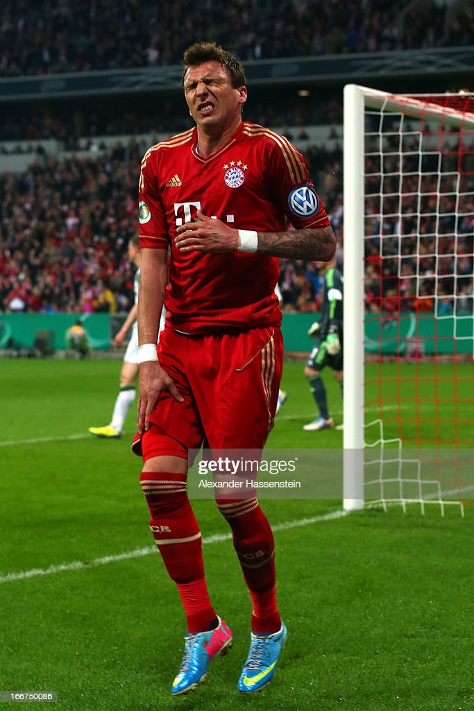 <a gi-track='captionPersonalityLinkClicked' href=/galleries/search?phrase=Mario+Mandzukic&family=editorial&specificpeople=4476149 ng-click='$event.stopPropagation()'>Mario Mandzukic</a> of Muenchen reacts after scoring the opening goal during the DFB Cup Semi Final match between Bayern Muenchen and VfL Wolfsburg at Allianz Arena on April 16, 2013 in Munich, Germany.