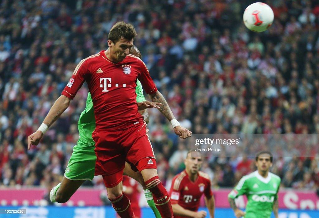 Mario Mandzukic of Muenchen scores his team's third goal during the Bundesliga match between FC Bayern Muenchen and VfL Wolfsburg at Allianz Arena on September 25, 2012 in Munich, Germany.