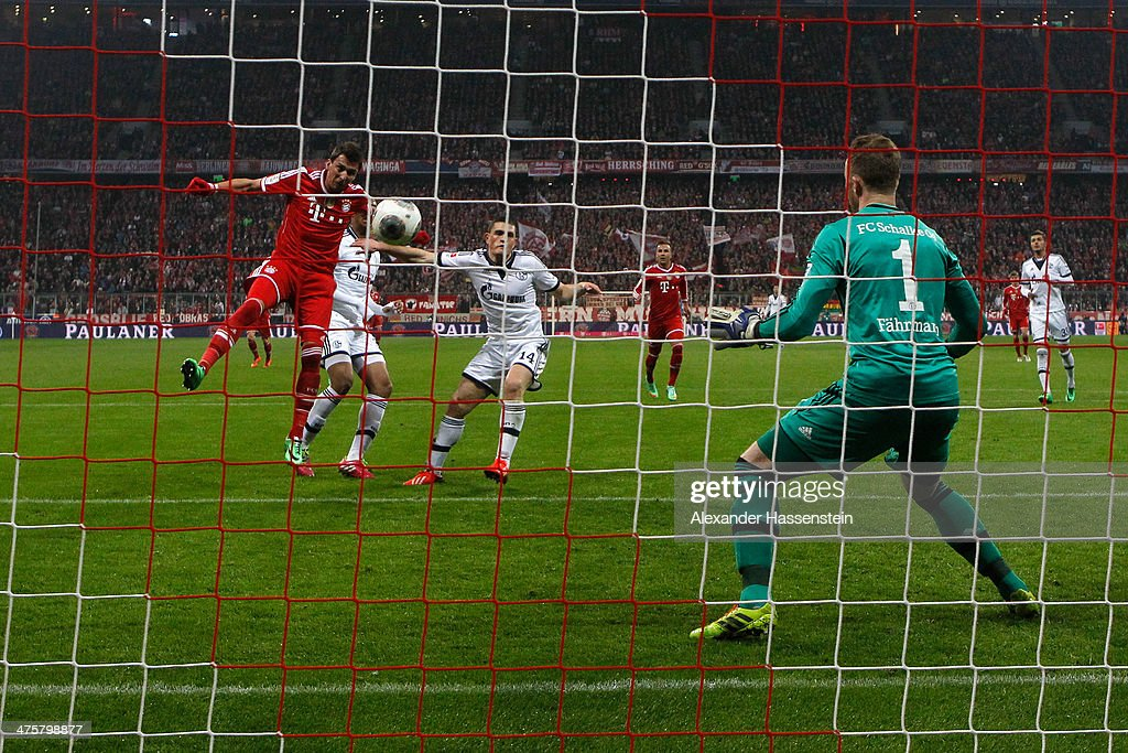 <a gi-track='captionPersonalityLinkClicked' href=/galleries/search?phrase=Mario+Mandzukic&family=editorial&specificpeople=4476149 ng-click='$event.stopPropagation()'>Mario Mandzukic</a> of Muenchen scores the 3rd team goal against <a gi-track='captionPersonalityLinkClicked' href=/galleries/search?phrase=Ralf+Faehrmann&family=editorial&specificpeople=808591 ng-click='$event.stopPropagation()'>Ralf Faehrmann</a> keeper of Schalke during the Bundesliga match between FC Bayern Muenchen and FC Schalke 04 at Allianz Arena on March 1, 2014 in Munich, Germany.