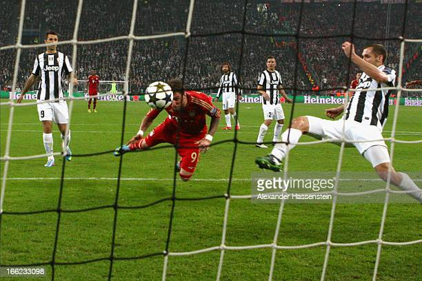 Mario Mandzukic of Munich scores the opening goal during the UEFA Champions League quarterfinal second leg match between Juventus and FC Bayern...