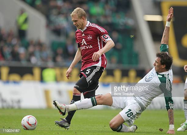 Mario Mandzukic of Wolfsburg battles for the ball with Andreas Wolf of Nuernberg during the Bundesliga match between VfL Wolfsburg and 1 FC Nuernberg...
