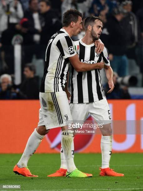 Mario Manzdzukic celebrates his first goal with Miralem Pjanic of Juventus during the UEFA Champions League group D match between Juventus and...