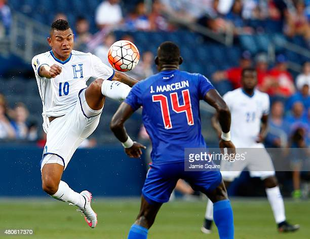 Mario Martinez of Honduras controls the ball as James Marcelin of Haiti defends during the 2015 CONCACAF Gold Cup match at Sporting Park on July 13...