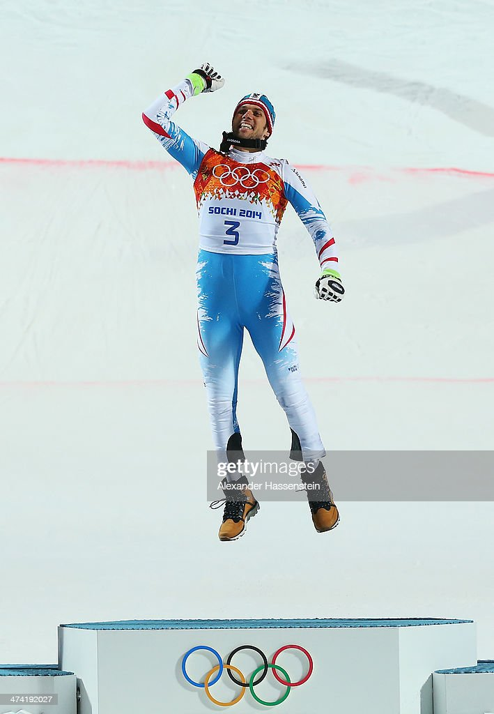 Mario Matt of Austria celebrates on the podium after winning gold during the medal ceremony for the Men's Slalom during day 15 of the Sochi 2014 Winter Olympics at Rosa Khutor Alpine Center on February 22, 2014 in Sochi, Russia.