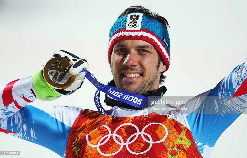 Mario Matt of Austria celebrates on the podium with his gold medal during the medal ceremony for the Men's Slalom during day 15 of the Sochi 2014 Winter Olympics at Rosa Khutor Alpine Center on February 22, 2014 in Sochi, Russia.