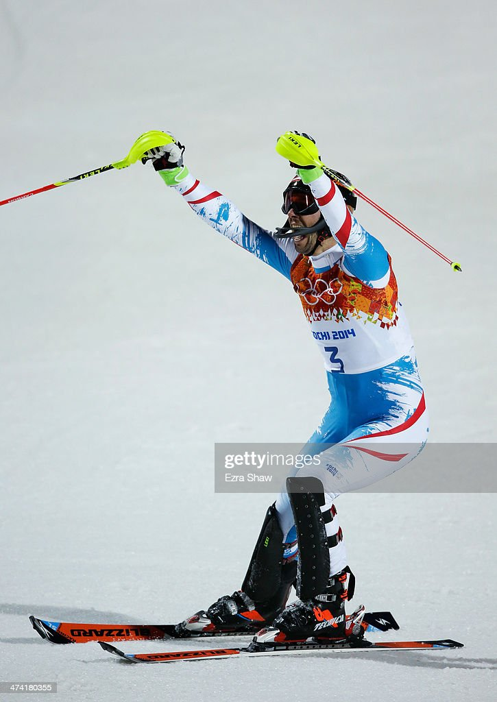 Mario Matt of Austria celebrates winning gold after finishing the second run during the Men's Slalom during day 15 of the Sochi 2014 Winter Olympics at Rosa Khutor Alpine Center on February 22, 2014 in Sochi, Russia.