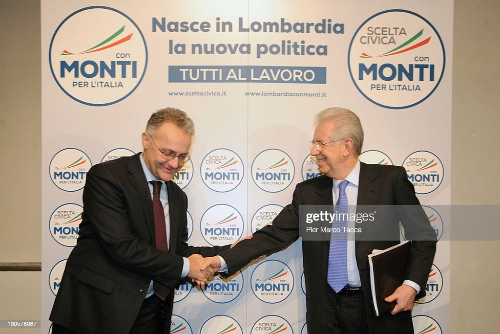 Mario Mauro and Italian Prime Minister <a gi-track='captionPersonalityLinkClicked' href=/galleries/search?phrase=Mario+Monti&family=editorial&specificpeople=632091 ng-click='$event.stopPropagation()'>Mario Monti</a> attend the presentation of Lombardy candidates of 'Scelta Civica con Monti per l'Italia' on February 2, 2013 in Milan, Italy. Monti used the rally to unveil the list of Lombardy candidates for the 'Civic Choice' (Scelta Civica) movement that will be running in February's parliamentary elections.