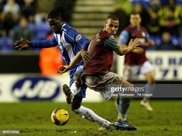 Mario Melchiot Wigan Athletic and Gabriel Agbonlahor Aston Villa battle for the ball