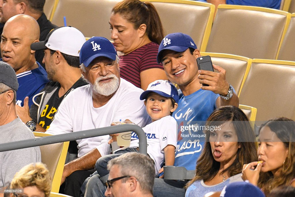 Mario Michael Lopez Sr Dominic Lopez and Mario Lopez attend a baseball game between the Pittsburgh Pirates and the Los Angeles Dodgers at Dodger...