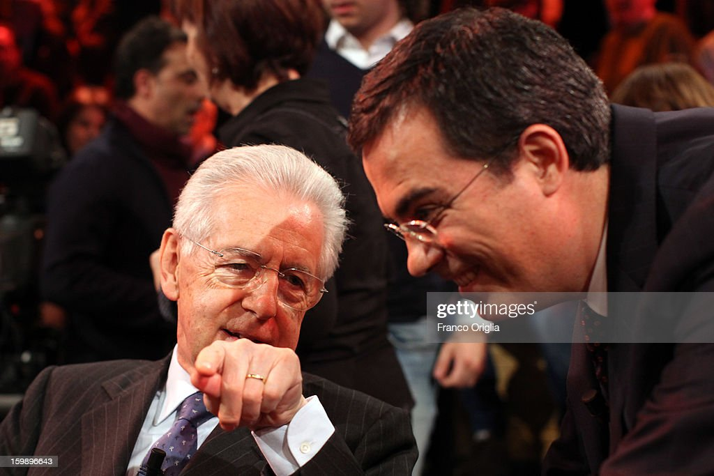 Mario Monti (R) and Italian TV conductor Giovanni Floris (L) attend Ballaro' Italian TV Show on January 22, 2013 in Rome, Italy. Outgoing Italian prime minister Mario Monti will lead a centrist alliance during the Italian elections in February.