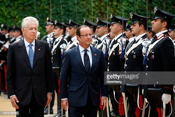 Mario Monti Italy's prime minister left and Francois Hollande France's president inspect a guard of honor as they arrive for their meeting at Villa...