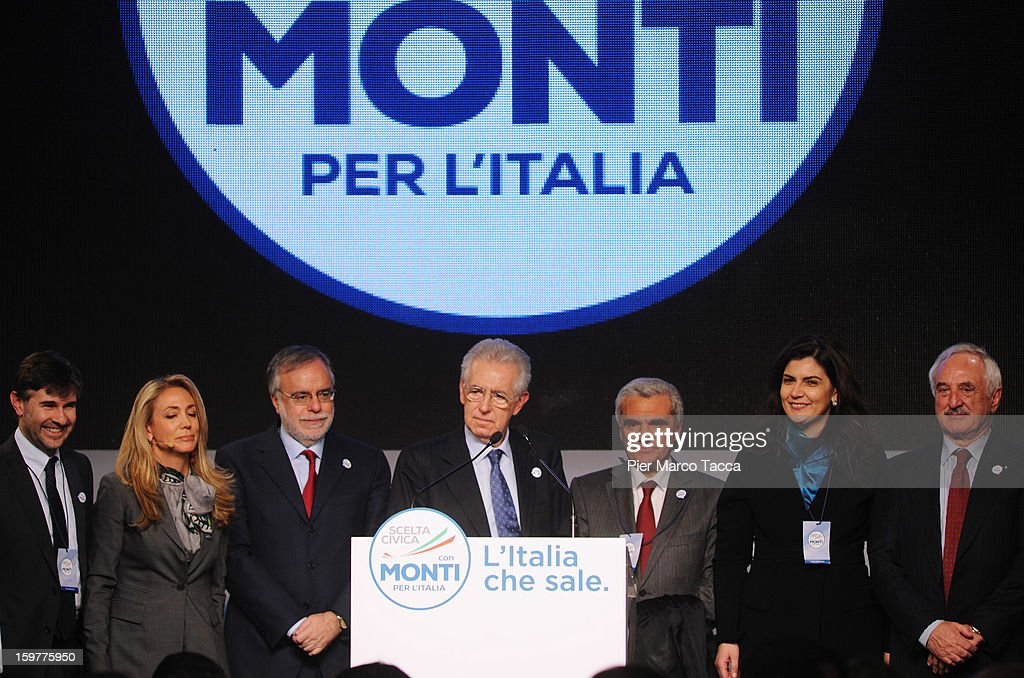 Mario Monti stands with the candidates he presented for the 'Civic Choice' movement in his speech at a campaign rally for his centrist alliance 'With Monti For Italy' (Con Monti Per L'Italia) at Kilometro Rosso on January 20, 2013 in Bergamo, Italy. Monti used the rally to unveil the list of candidates for the 'Civic Choice' (Scelta Civica) movement, a bloc that will form part of the centrist alliance running in February's parliamentary elections.