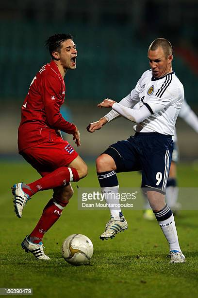 Mario Mutsch of Luxembourg is tackled and fouled by Kenny Miller of Scotland during the International Friendly match between Luxembourg and Scotland...