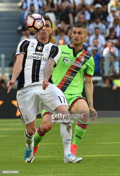 Mario Nandzukic of FC Juventus in action against Diego Falcinelli of Crotone FC during Italian Serie A football match between Juventus and FC Crotone...