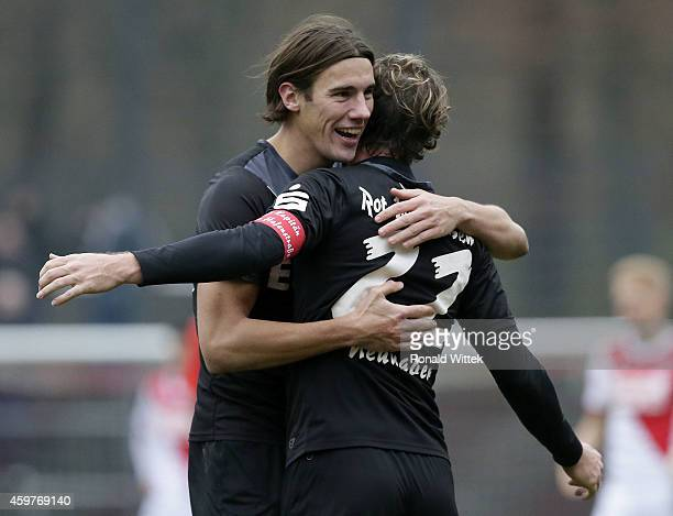 Mario Neunaber of Essen celebrates with Philipp Zeiger after the match during the Regionalliga West match between 1 FC Koeln II and RotWeiss Essen at...