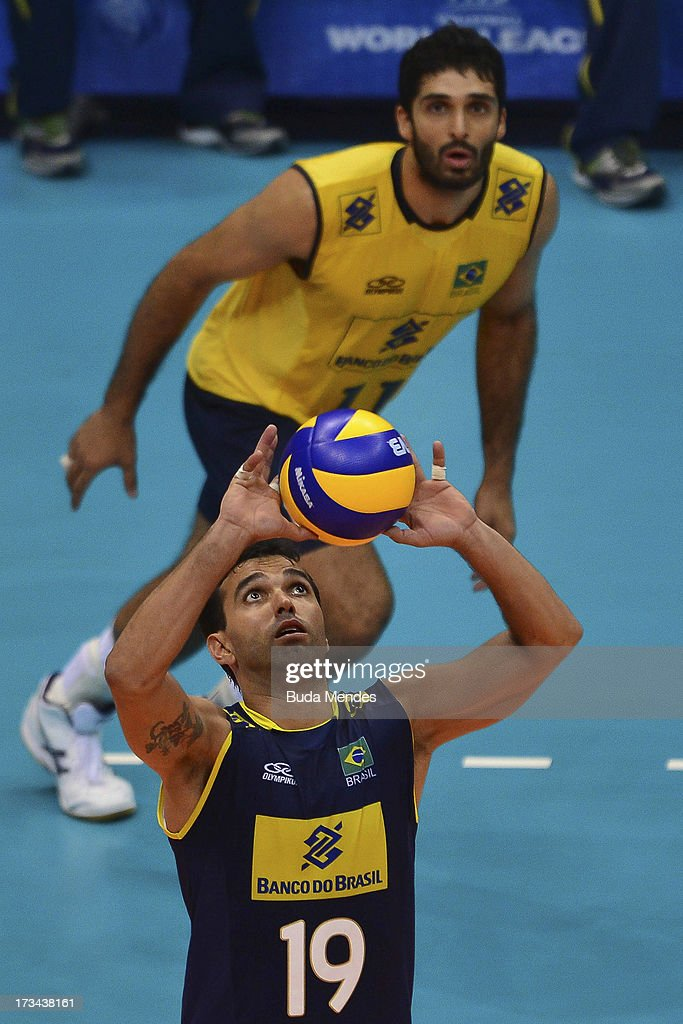 Mario (#19) of Brazil in action against USA during a match between Brazil and USA as part of the FIVB Volleyball World League 2013 at the Maracanazinho gymnasium on July 14, 2013 in Rio de Janeiro, Brazil.