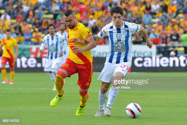 Mario Osuna of Morelia and Angelo Sagal of Pachuca fight for the ball during the fifth round match between Morelia and Pachuca as part of the Torneo...