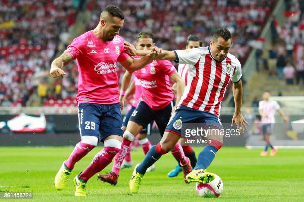 Mario Osuna of Morelia and Edwin Hernandez of Chivas fight for the ball during the 13th round match between Chivas and Morelia as part of the Torneo...