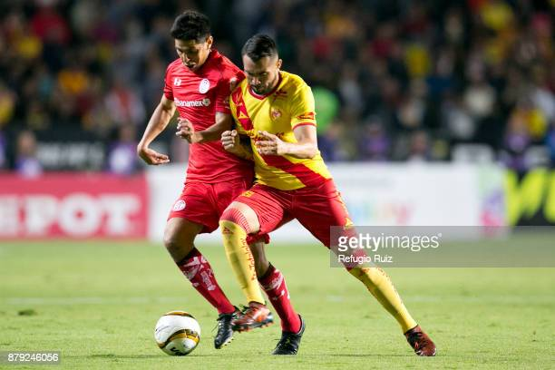 Mario Osuna of Morelia fights for the ball with Pablo Barrientos of Toluca during the quarter finals second leg match between Morelia and Toluca as...