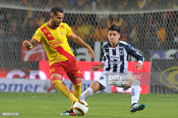 Mario Osuna of Morelia vies for the ball with Jonathan Gonzalez of Monterrey during their Mexican Apertura tournament first leg semifinal football...