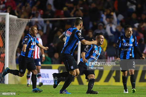 Mario Osuna of Queretaro celebrates with teammates after scoring the winning goal of his team during a match between Queretaro and Chivas as part of...