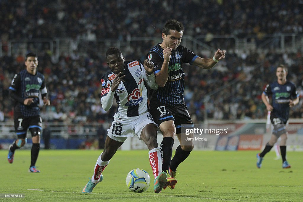 Mario Osuna (R) of Queretaro struggles for the ball with Avilas Hurtado (L) of Pachuca during a match between Pachuca and Queretaro as part of the Clausura 2013 Liga MX at Hidalgo Stadium on January 19, 2013 in Pachuca, Mexico.
