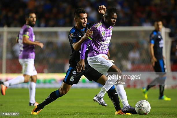 Mario Osuna of Queretaro struggles for the ball with Aviles Hurtado of Chiapas during the 11th round match between Queretaro and Chiapas as part of...