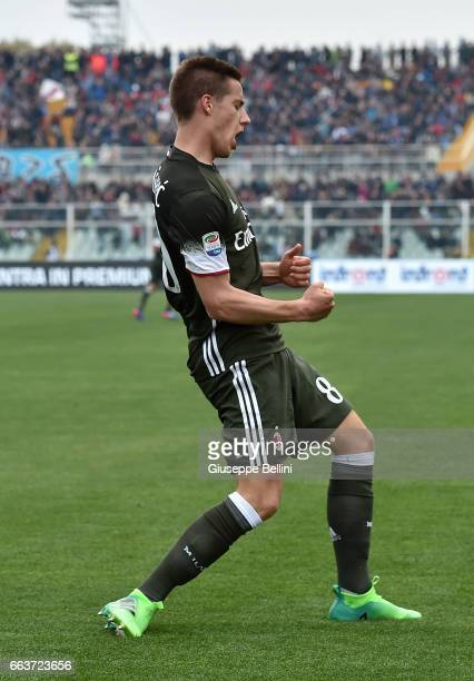 Mario Pasalic of AC Milan celebrates after scoring goal 11 during the Serie A match between Pescara Calcio and AC Milan at Adriatico Stadium on April...