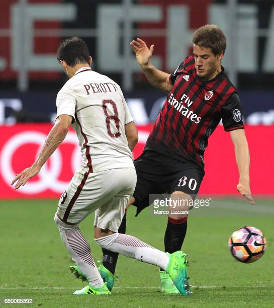 Mario Pasalic of AC Milan competes for the ball with Diego Perotti of AS Roma during the Serie A match between AC Milan and AS Roma at Stadio...