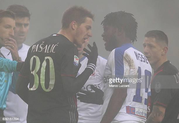 Mario Pasalic of AC Milan disputes with Franck Kessie of Atalanta BC during the Serie A match between AC Milan and Atalanta BC at Stadio Giuseppe...