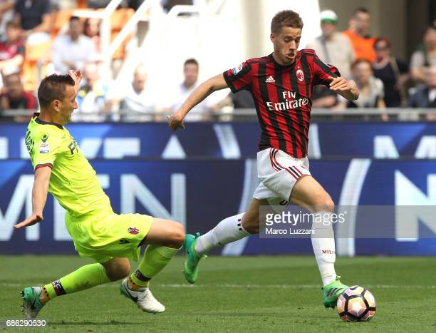 Mario Pasalic of AC Milan is challenged by Daniele Gastaldello of Bologna FC during the Serie A match between AC Milan and Bologna FC at Stadio...