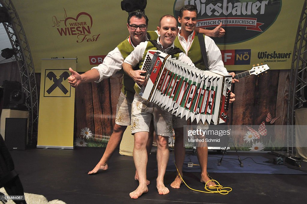 Mario Reitbauer, Andreas Schlintl and Christian Schauperl of Alpenyetis pose on stage during the 'Wiener Wirten Tag' as part of Wiener Wiesn Festival 2013 on September 25, 2013 in Vienna, Austria.